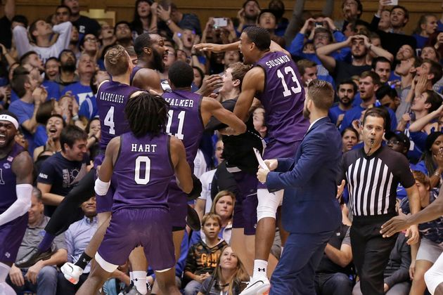 Stephen F. Austin players celebrated the team's 85-83 overtime upset win over No. 1