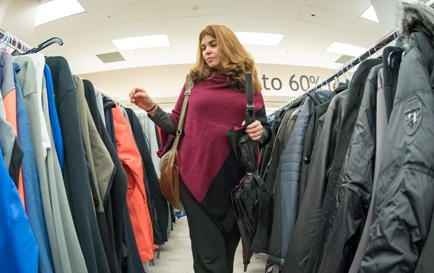 A woman browses through winter clothing at a Winners store in Toronto on Sept. 23,