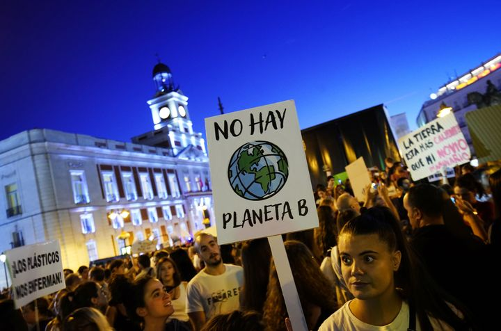 "A woman holds a placard reading ""There is no Planet B"" during a protest demanding global politicians take urgent action to fi"