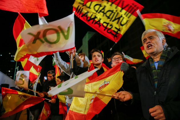 Supporters of Spain's far-right party Vox wave flags in Madrid during the Spanish election in