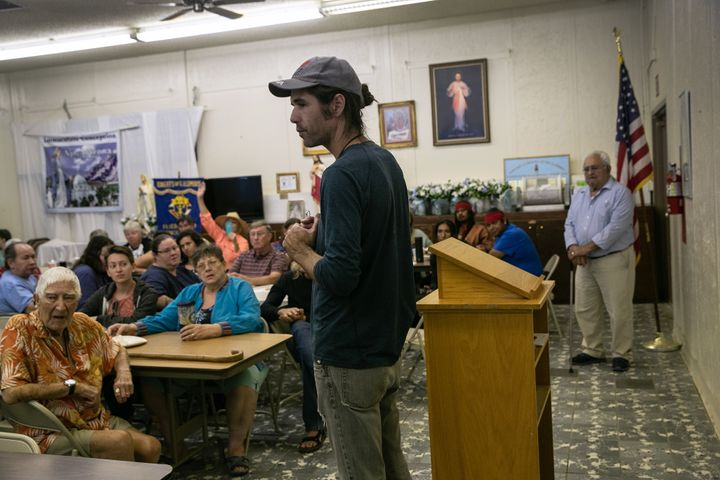 Scott Warren, a volunteer for the humanitarian aid organization No More Deaths, speaks at a community meeting to discuss fede