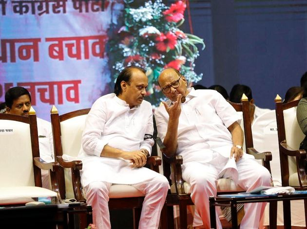A file photo of Ajit Pawar (left) with uncle Sharad Pawar in