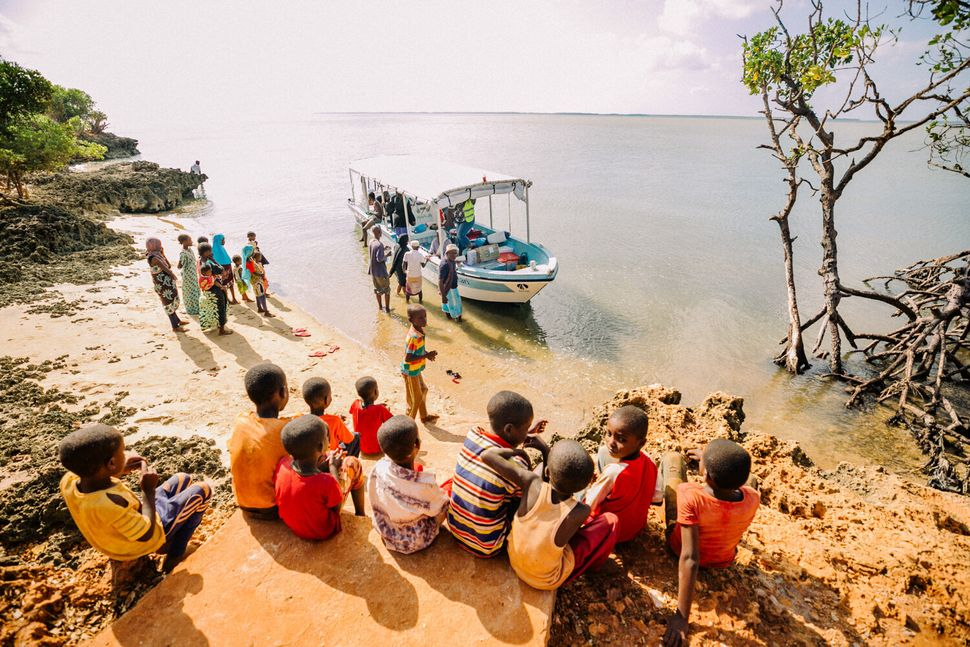 The Safari Doctors team packs medicines in boats and travels to remote villages where health care is a luxury.