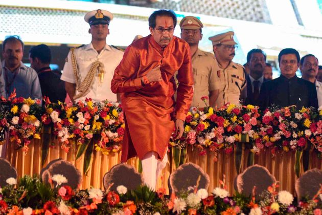 Maharashtra's new chief minister Uddhav Thackeray bows after taking his oath of office during his swearing-in...