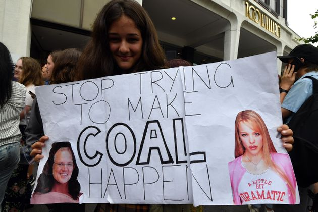 A student in Sydney holds up a placard during a rally calling for action on climate