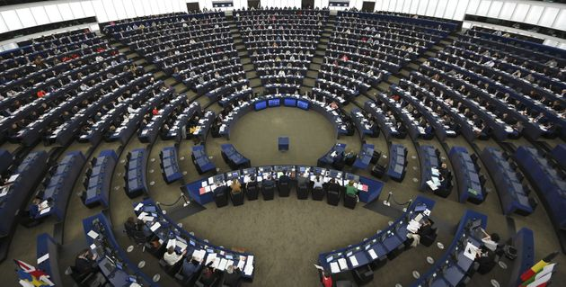 Members of the European Parliament take part in a voting session during a plenary session at the European...