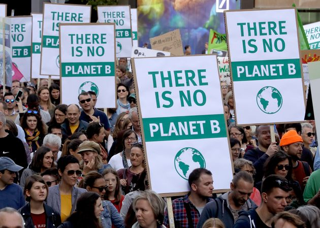 People attend a 'Fridays For Future' rally in Frankfurt, Germany, Friday, Sept. 20, 2019. Protests of...
