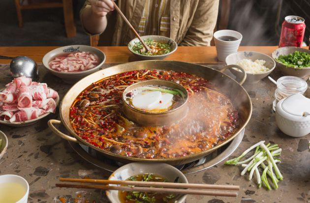 A person is eating hotpot