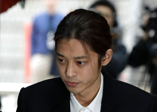 K-pop singer Jung Joon-young arrives to attend a hearing at the Seoul Central District Court in Seoul,...