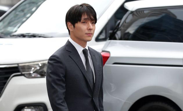 Choi Jong-Hoon, aka Jonghoon (Jong Hoon) former member of South Korean boy band FTisland is seen arriving at a Seoul police station for questioning over a sex video scandal among multiple celebrities on March 16, 2019 in Seoul.