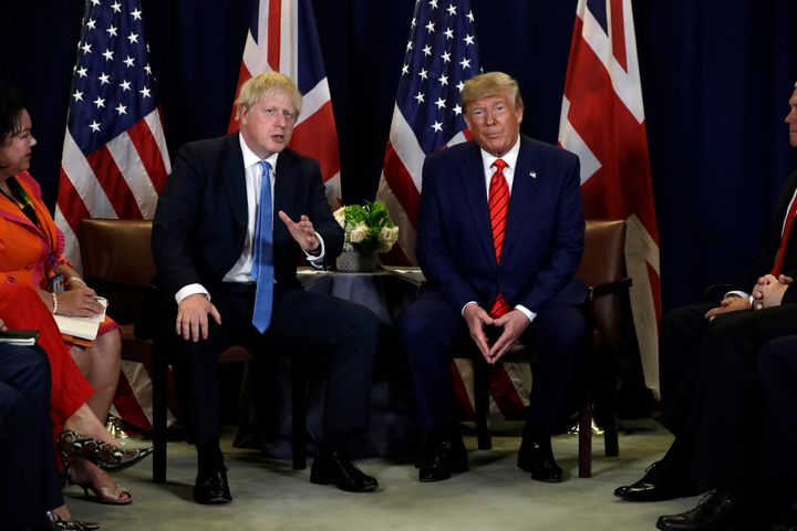 UK Prime Minister Boris Johnson, left, said it was best if U.S. President Donald Trump, right, did not get involved in Britai