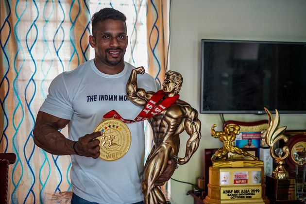 Chitharesh Natesan with his Mr Universe medal and trophy.