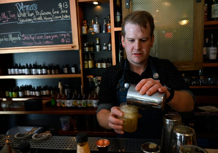 Bartender Dan Purcell mixes up a pineapple-rosemary shrub mocktail at Vena's Fizz House in Portland, Maine.