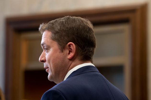 Conservative Leader Andrew Scheer speaks with the media in the Foyer of the House of Commons in West...
