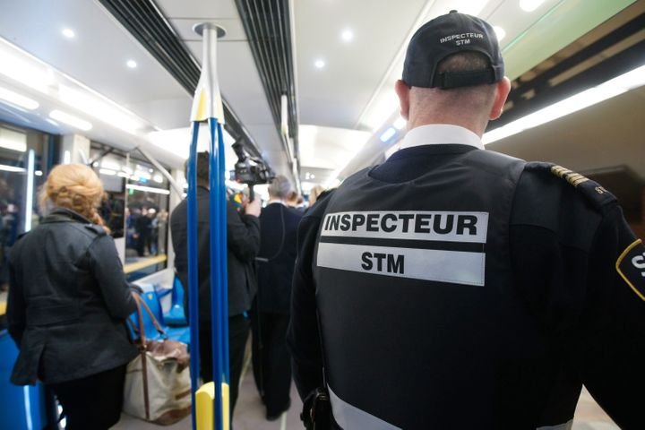 The Supreme Court slammed The Societe de transport de Montreal, Montreal's transit police service, for detaining a woman for not holding a handrail. An STM inspector unrelated to the case is pictured here on Feb., 7, 2016.