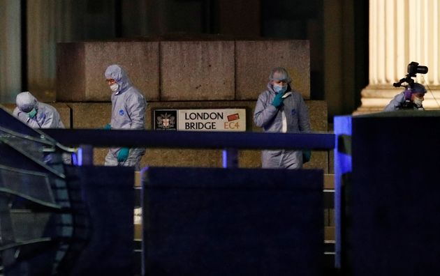 Forensics officers are seen near the site of an incident at London Bridge in London, Britain, November...