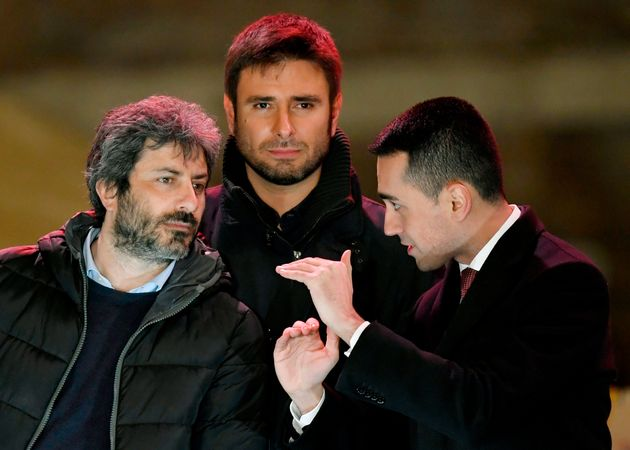 Italy's populist Five Star Movement (M5S) party leader Luigi Di Maio (R) and M5S members Roberto Fico (L) and Alessandro Di Battista after the last election campaign meeting in Piazza del Popolo in Rome on March 2, 2018. Italy's anti-establishment Five Star Movement broke with tradition on March 1, 2018, by announcing its list of ministerial candidates, almost all of them political newcomers, before March 4 general election. / AFP PHOTO / Andreas SOLARO        (Photo credit should read ANDREAS SOLARO/AFP via Getty Images)