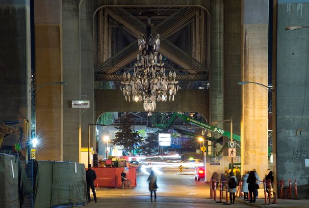 An art installation of a giant chandelier with a cost of over $4 million is pictured under the Granville...