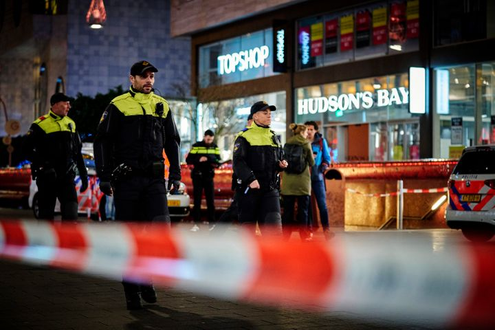 Dutch police secure a shopping street after a stabbing incident in the center of The Hague, Netherlands, Friday, Nov. 29, 201