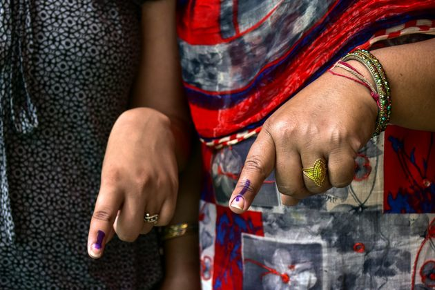 PATIALA, PUNJAB, INDIA - 2019/05/19: Indian voters seen showing their inked fingers after casting their vote at a polling station during the final phase of India's general election in Patiala district of Punjab. Voting has begun for the final phase of Lok Sabha elections in Punjab, Bihar, West Bengal, Madhya Pradesh, Uttar Pradesh, Himachal Pradesh, Jharkhand and Chandigarh. Over 10.01 lakh voters will decide the fate of 918 candidates. The counting of votes will take place on May 23, officials said. (Photo by Saqib Majeed/SOPA Images/LightRocket via Getty Images)