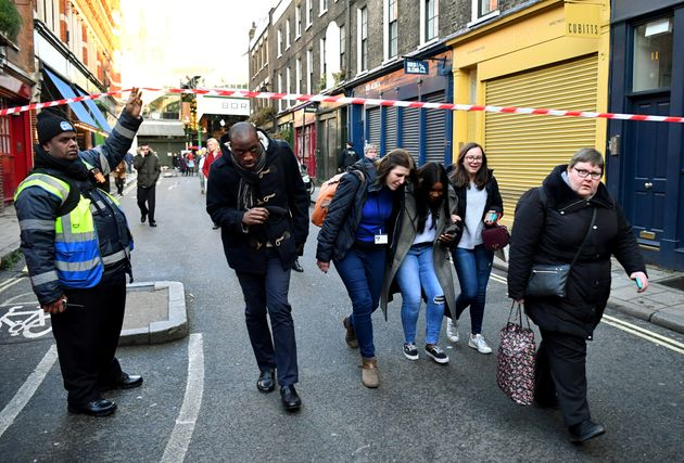 People being allowed to pass a cordon near Borough Market in the wake of the incident on Friday