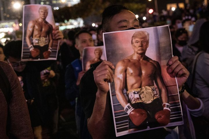 Pro-democracy protesters hold posters of President Donald Trump (as Rocky Balboa) during a rally at Edinburgh Place on Nov. 2
