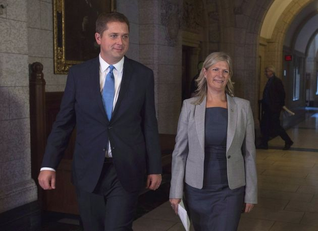 Andrew Scheer walks with Leona Alleslev in Parliament Hill in Ottawa, on Sept. 17,