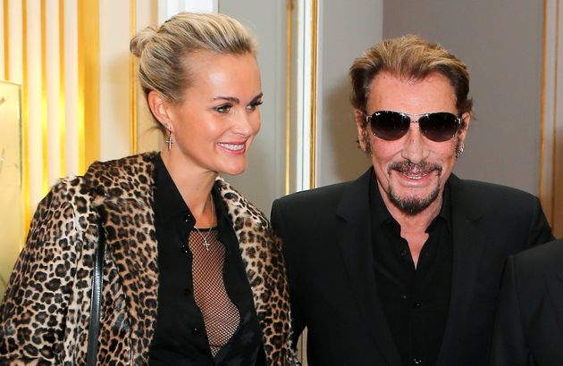 French rock singer Johnny Hallyday and his wife Laeticia attend an award ceremony for U.S actor Harvey...
