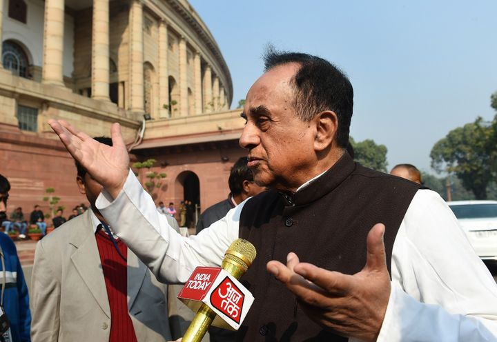 BJP leader Subramaniam Swamy interacts with members of the media at Parliament House in New Delhi on December 17, 2015.