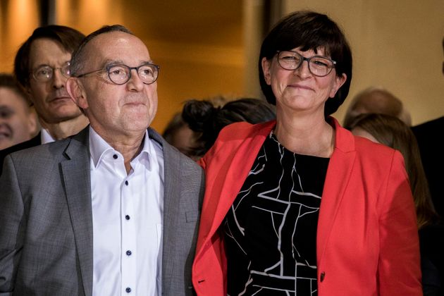 BERLIN, GERMANY - OCTOBER 26: Norbert Walter-Borjans (L) and Saskia Esken (R) of the of Social Democratic Party of Germany (SPD), react after counting ballots of SPD members who voted for a new party leadership at the headquarter of the Social Democratic Party of Germany (SPD) on October 26, 2019 in Berlin, Germany. Six pairs of candidates, one man and one woman each, have vied for the position following a nationwide tour after several others bowed out. The SPD, traditionally one of Germany's strongest, mainstream parties, has suffered a significant loss in its base over recent years, including an erosion of working class support to the right-wing Alternative for Germany (AfD). The new leadership pair is to put the party back on a clear policy course and win back voters. (Photo by Carsten Koall/Getty Images)