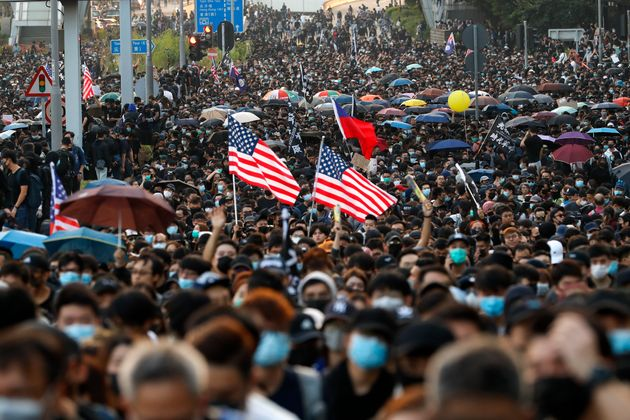 Pro-democracy protesters flood a street during a rally in Hong Kong, Sunday, Dec. 1, 2019. A huge crowd...