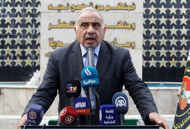 Iraqi Prime Minister Adel Abdul Mahdi speaks during a symbolic funeral ceremony of Major General Ali...