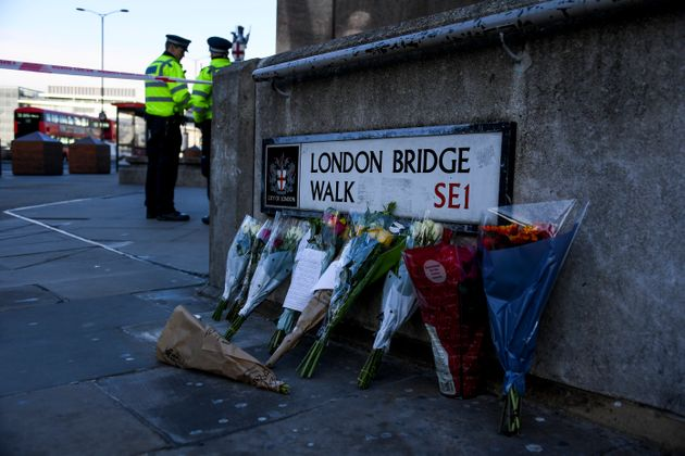 Flowers are left following Friday's terror attack on London Bridge in London, Sunday, Dec. 1, 2019. A...