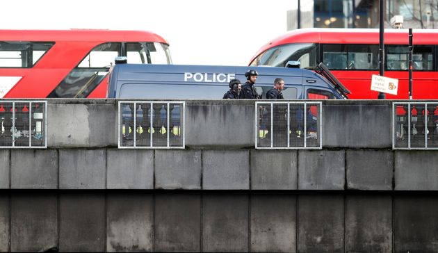 Police officers and emergency staff work at the site of an incident at London Bridge in London, Britain,...
