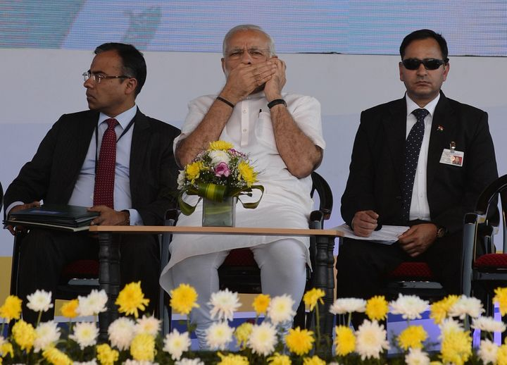Prime Minister Narendra Modi speaks on a mobile phone on January 3, 2016.