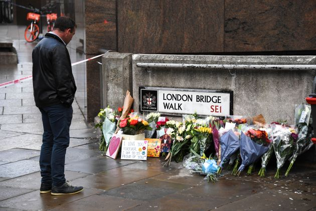 Flowers and a pictures are left in memory of the victims of the terror attack on London