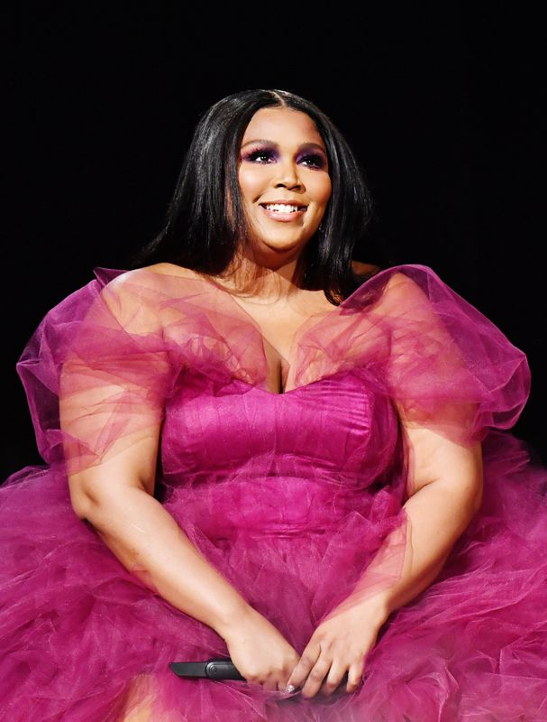 Lizzo performing at the American Music Awards in Los Angeles on Nov. 24. Makeup by Alexx Mayo. Hair by Shelby Swain.