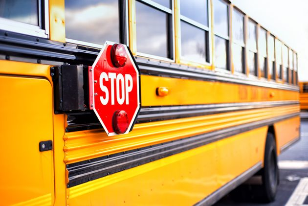 Five students are in critical condition after a collision between a school bus and truck-mounted crane...