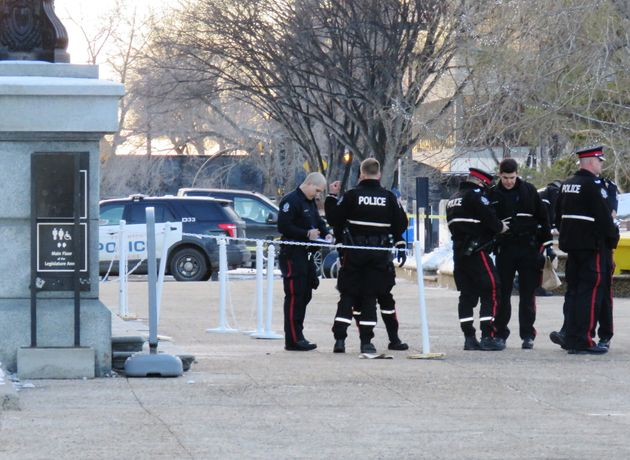 Police stand outside of the Alberta Legislature after being called for a weapons complaint related to...