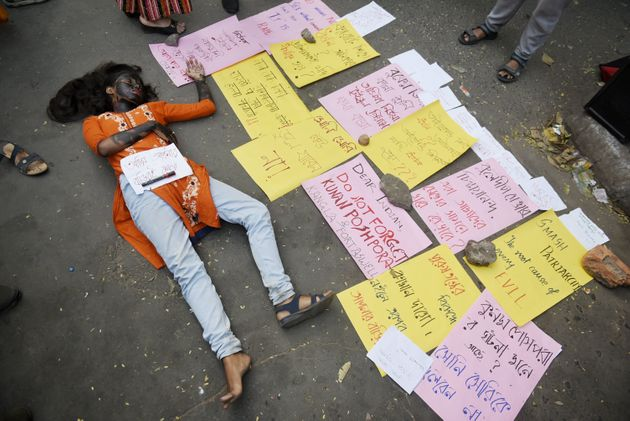 Students acts as a rape victim to protest against the alleged rape and murder of a 27-year-old veterinary...