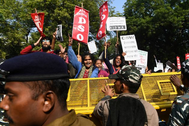 Demonstrators shout slogans to protest against the alleged rape and murder of a 27-year-old veterinary...