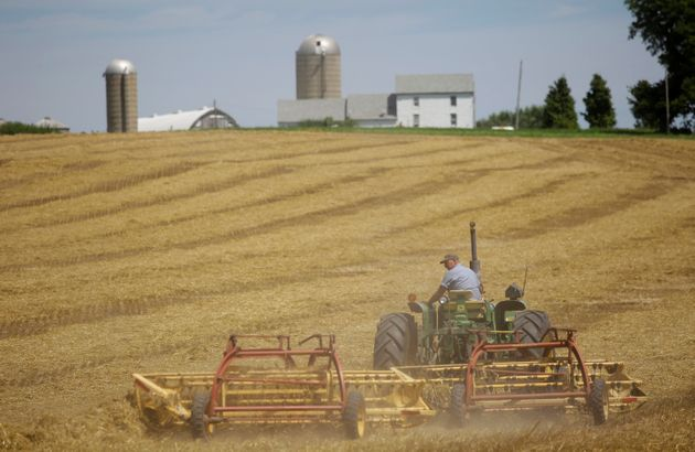 Farmer Mark Klinger harvest his field at his farm in Pecatonica, Illinois, U.S., July 25, 2018. Photo...