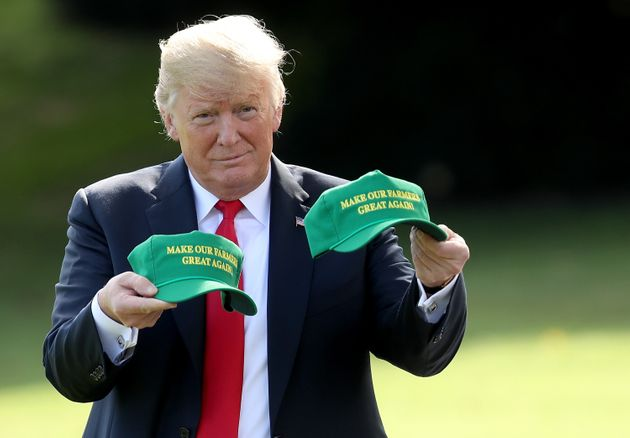WASHINGTON, DC - AUGUST 30: U.S. President Donald Trump holds up two hats that say