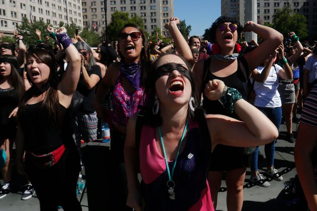 Women perform during the demonstration 'Un violador en tu camino' organized by feminist group Lastesis...