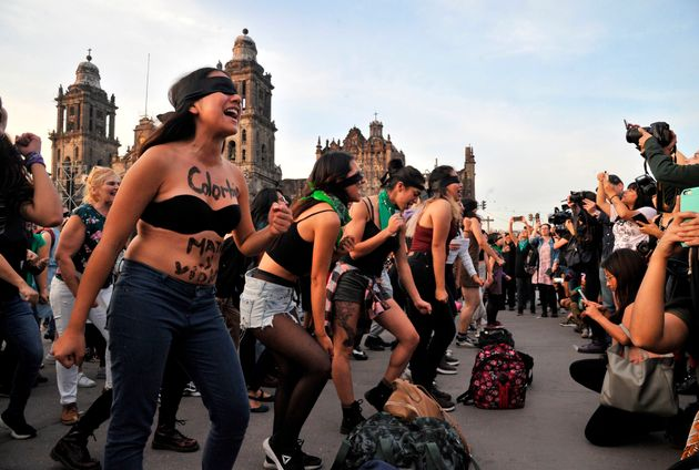 Women recreate a feminist choreographed performance at the Zocalo square in Mexico City, on November...