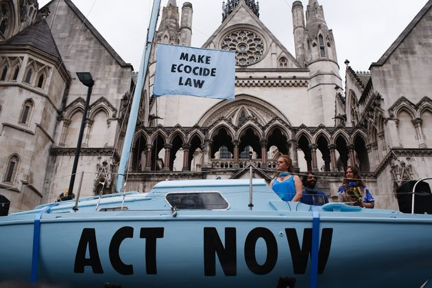 Climate change activist group Extinction Rebellion demonstrates outside the Royal Courts of Justice in...