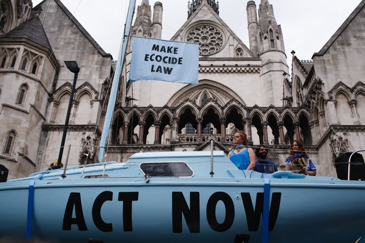 Climate change activist group Extinction Rebellion demonstrates outside the Royal Courts of Justice in London in July 2019 wi