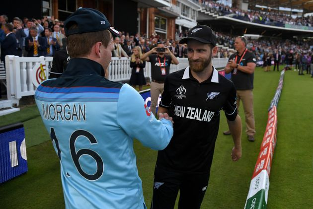 England captain Eoin Morgan with New Zealand captain Kane Williamson after winning the Final of the ICC...