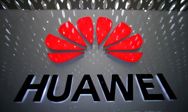 A Huawei sign is displayed at the Shenzhen International Airport in Shenzhen, China, on July 22, 2019....