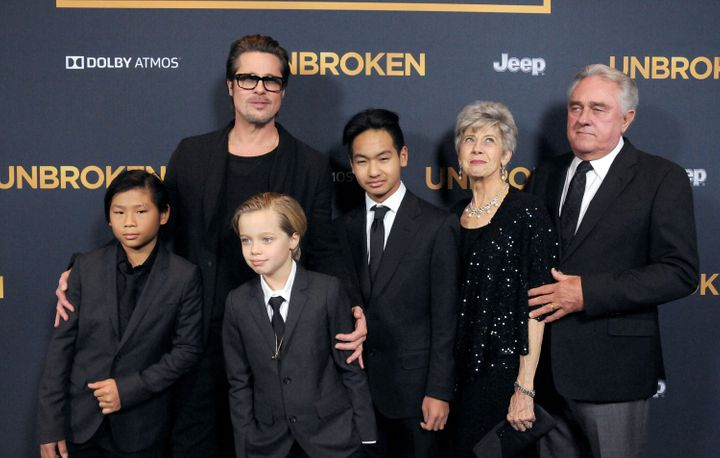 "Brad Pitt arrives at the premiere of ""Unbroken"" with children Pax, Shiloh, Maddox and parents Jane Pitt and William Pitt in 2"